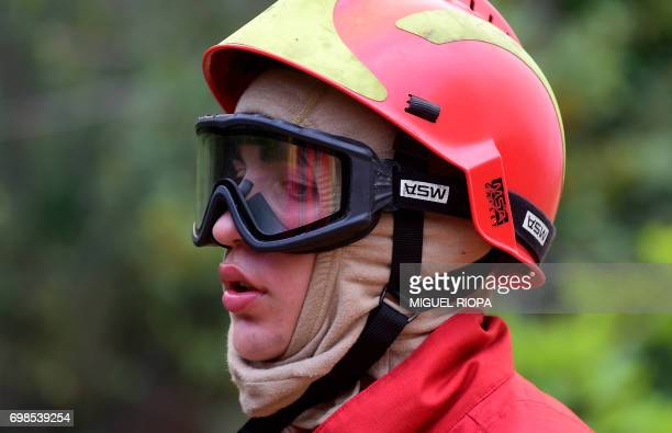 A firefighter takes a breather as they combat a wildfire in Vale da Ponte Pedrograo Grande on June 20 2017 The huge forest fire that erupted on June...