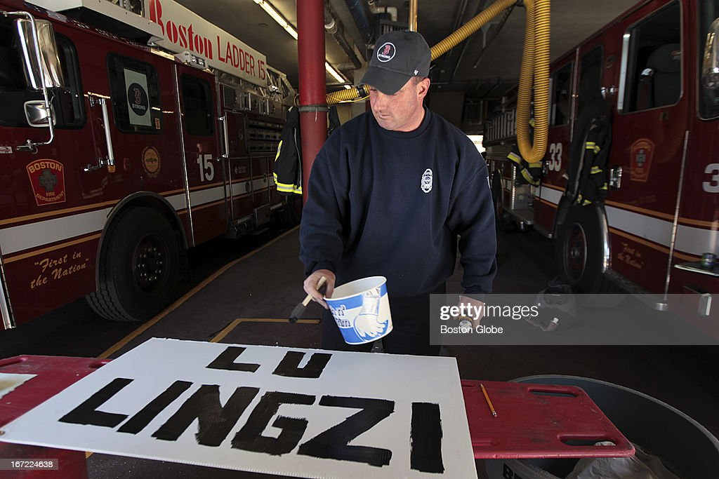 Firefighter Tim Freda from the Boylston Street Firehouse, Engine 33 Ladder 15 paints signs in honor of the victims to be hung at the firehouse before the moment of silence today at 2:50 p.m. Their firehouse was among first responders to the bombings last Monday. A moment of silence was held at 2:50 p.m. for the victims of the Boston Marathon bombings which occurred one week ago today.