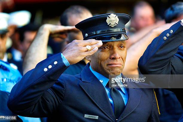 Firefighter Tony James cries while attending the funeral service for New York Fire Department Chaplain Rev Mychal Judge in front of the St Francis of...