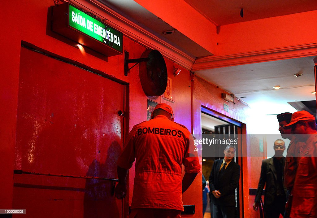 A firefighter tries an emergency exit during an inspection to a nightclub in a suburb of Brasilia, on February 2, 2013. The Brazilian authorities ordered the inspection of many bars and nightclubs all over the country after the blaze in the Kiss Nightclub in Santa Maria, southern Brazil, that left more than 230 people dead. AFP PHOTO/ Pedro LADEIRA