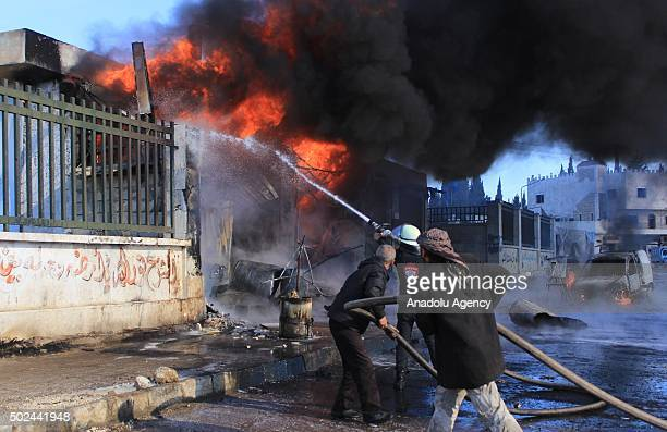 A firefighter tries to extinguish fire after the war crafts belonging to the Russian army carried out airstrikes on two hospital in the Azaz town of...