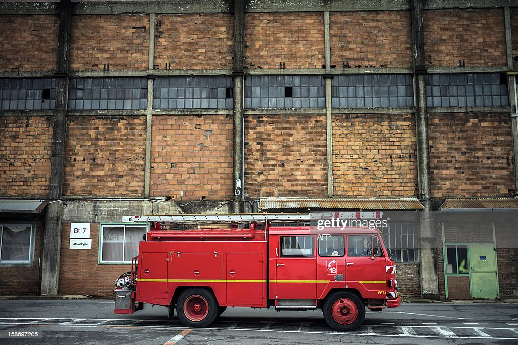 A firefighter truck is parked at Aperam stainless steel factory, controlled by the Mittal family, on December 24, 2012 in Gueugnon, central France, after a fire broke out overnight, burning 4000 square meters with no casualties.