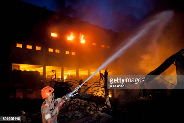 A firefighter try to douse flames after an explosion made a factory in Tongi Official said at least 23 people were killed and 70 injured in a boiler...