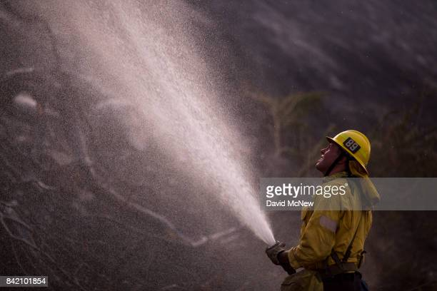 A firefighter using a hose to cool flames at the La Tuna Fire on September 2 2017 near Burbank California Los Angeles Mayor Eric Garcetti said at a...