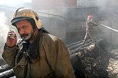 Firefighter using mobile phone