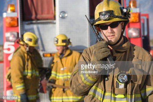 Firefighter using walkie talkie