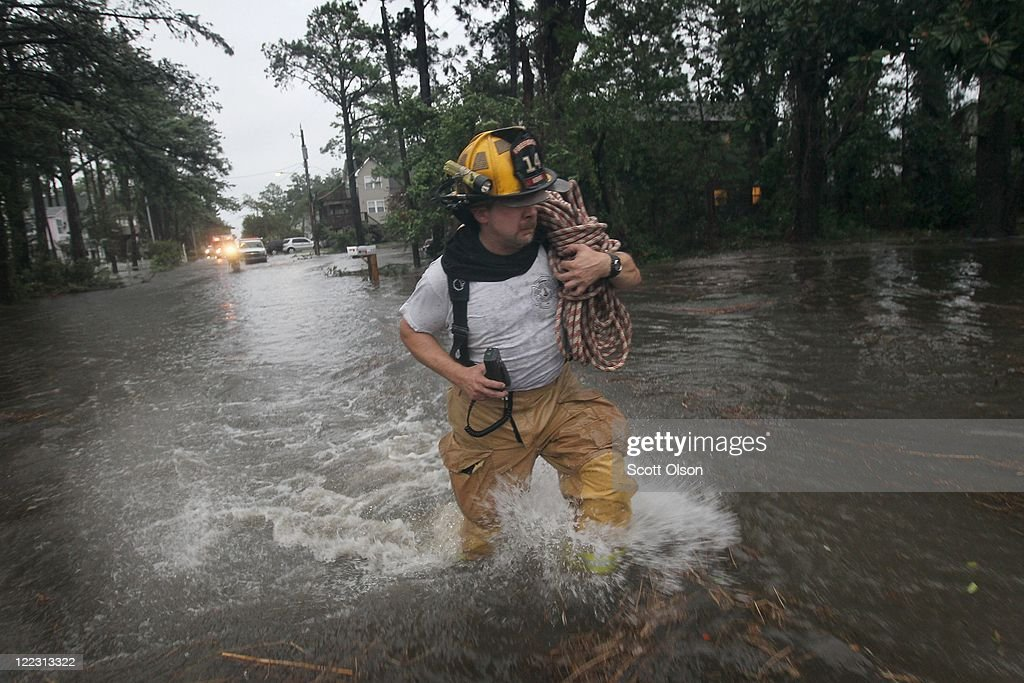A firefighter wades through floodwater as they respond to a call of a gas leak during Hurricane Irene on August 27, 2011 in Kill Devil Hills, North Carolina. Hurricane Irene hit Dare County, which sits along the Outer Banks and includes the vacation towns of Nags Head, Kitty Hawk and Kill Devil Hills, as a category one hurricane around mid-day today causing wind damage and flooding.