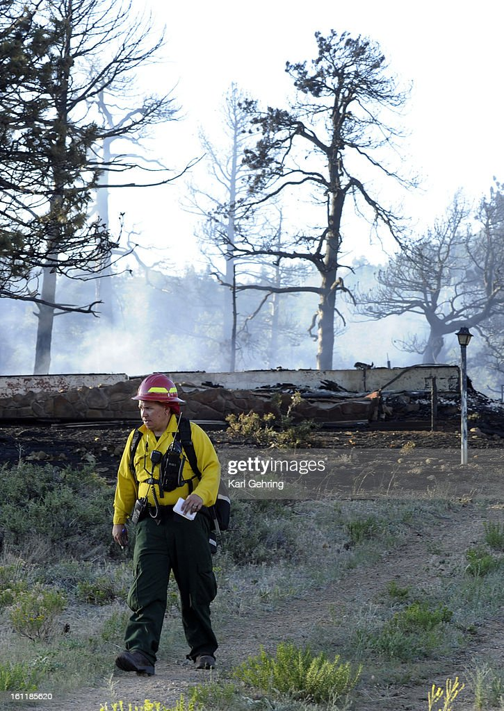 A firefighter walked out of the burn zone at the Woodland Heights fire in Estes Park Saturday An estimated 22 structures were consumed by fire before...