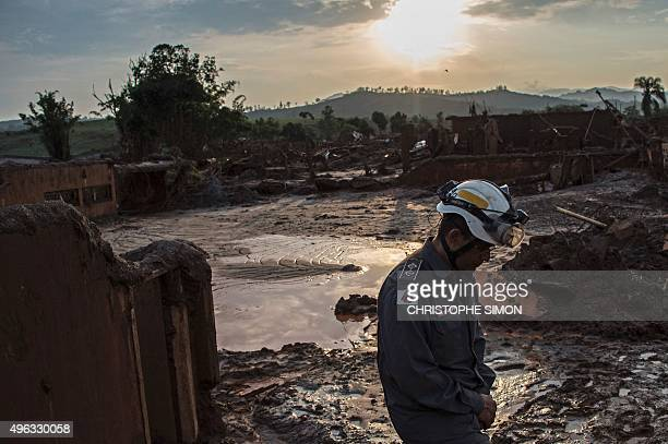 A firefighter walks in the mud in Bento Rodrigues three days after an avalanche of mud and mining sludge buried the town in southeastern Brazil on...