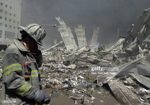 Firefighter walks through the rubble of the World Trade Center after it was struck by a commercial airliner in a terrorist attack A hijacked American...