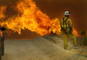 A firefighter watches the encroaching flames of the Crown fire The fire started closer to Acton and moved east toward Palmdale The fire burned over...