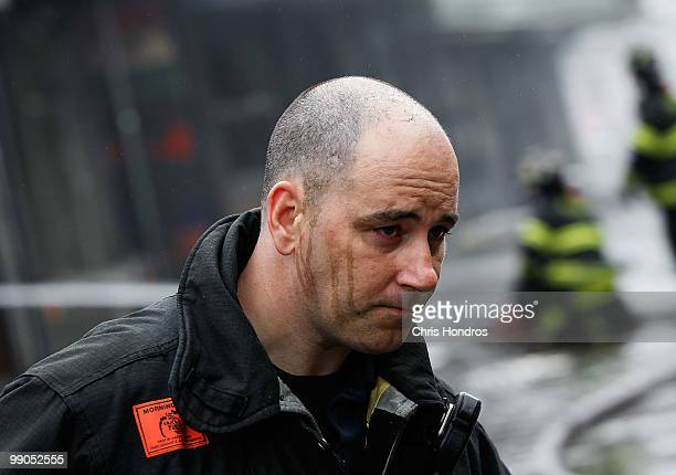 A firefighter with away after helping to douse a threealarm fire that broke out at 502 East 14th Street across from Stuyvesant Town in lower...