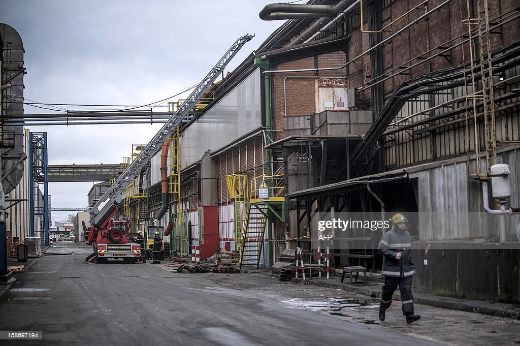Firefighter work at Aperam stainless steel factory, controlled by the Mittal family, on December 24, 2012 in Gueugnon, central France, after a fire broke out overnight, burning 4000 square meters with no casualties. AFP PHOTO / JEFF PACHOUD