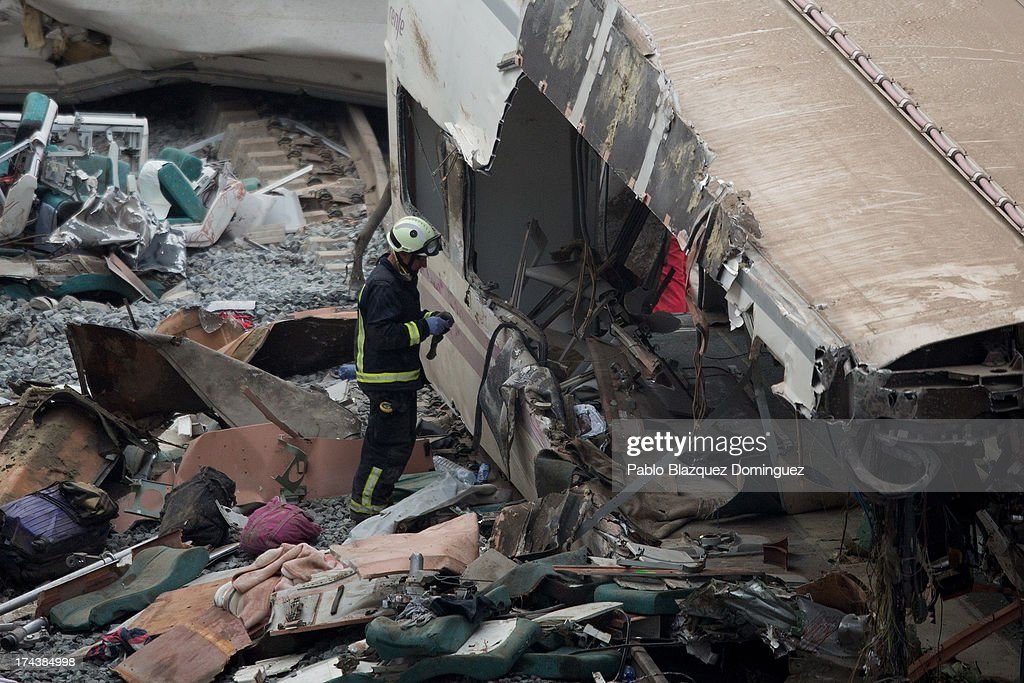 A firefighter works at the scene of a train crash that killed at least 77 people on July 25 2013 at Angrois near Santiago de Compostela Spain The...