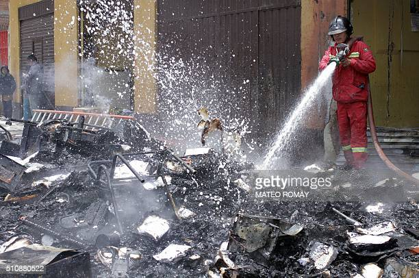 A firefighter works outside the City Hall in El Alto Bolivia on February 17 2016 Six people died from smoke inhalation when a crowd set fire to a...