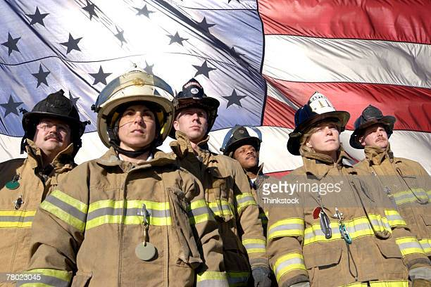 Firefighters and American flag