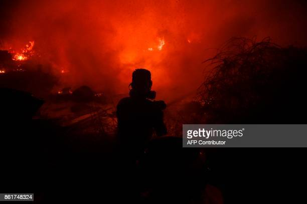 TOPSHOT Firefighters and civilians attempt to subdue wildfire flames in Vigo northwestern Spain October 15 2017 Hundreds of firefighters struggled on...