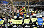 TOPSHOT Firefighters and emergency doctors work at the site of a train accident near Bad Aibling southern Germany on February 9 2016 Two commuter...