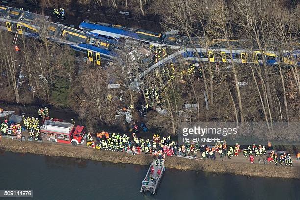 TOPSHOT Firefighters and emergency doctors work at the site of a train accident near Bad Aibling southern Germany on February 9 2016 Two Meridian...