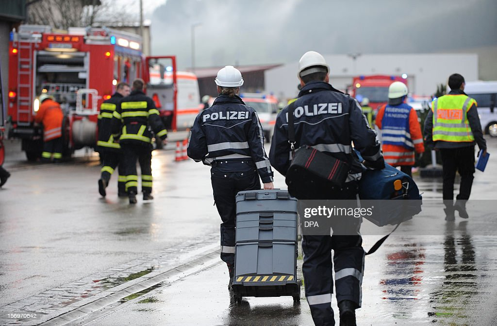 Firefighters and police work at the scene of a fire at a workshop for handicapped people in Titisee- Neustadt, southern Germany on November 26, 2012. Fourteen people died after a fire broke out.