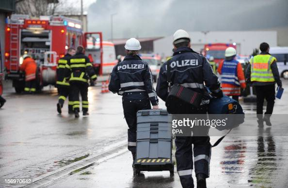 Firefighters and police work at the scene of a fire at a workshop for handicapped people in Titisee Neustadt southern Germany on November 26 2012...
