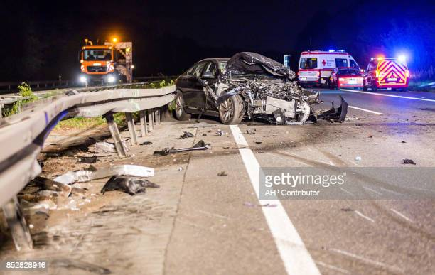 Firefighters and police work on the site of an accident on September 23 2017 on the motorway A67 near Ruesselsheim western Germany where a wrongway...