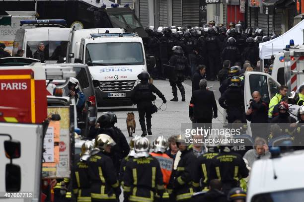Firefighters and policemen are gathered in the northern Paris suburb of SaintDenis city center on November 18 as French Police special forces raid an...