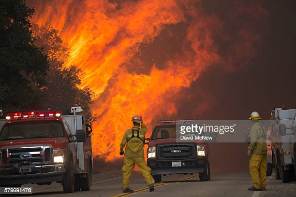 Firefighters are forced to retreat as flame close in on them in Placerita Canyon at the Sand Fire on July 24 2016 in Santa Clarita California...