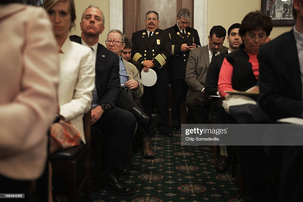 Firefighters are left with standing room only during a House Homeland Security Committee hearing about the Boston Marathon bombings on Capitol Hill May 9, 2013 in Washington, DC. Witnesses told the committee that, although federal and local law enforcement handled the bombing and subsequent investigation and capture of a suspect, better counter-terrorism communication between agencies could have prevented the bombing.