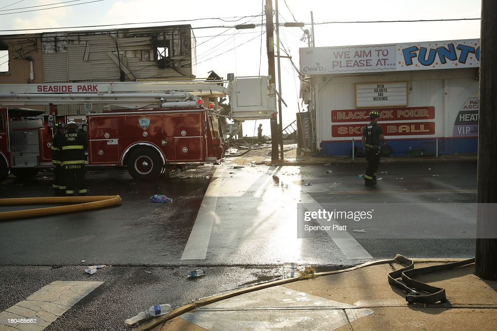 Firefighters are viewed at the scene of a massive fire that destroyed dozens of businesses along an iconic Jersey shore boardwalk on September 13, 2013 in Seaside Heights, New Jersey. The 6-alarm fire began in a frozen custard stand on the recently rebuilt boardwalk around 2:00 p.m. on Thursday, September 12, and quickly spread in high winds. While there were no injuries reported, many businesses that had only recently re-opened after Hurricane Sandy were destroyed in the blaze.
