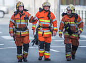 Firefighters arrive at a security perimeter set in the Rue de la Loi near the Maalbeek Maelbeek subway station in Brussels on March 22 after an...