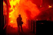 Firefighters attempt to save a burning house during the Valley fire in Seigler Springs California on September 13 2015 The governor of California...