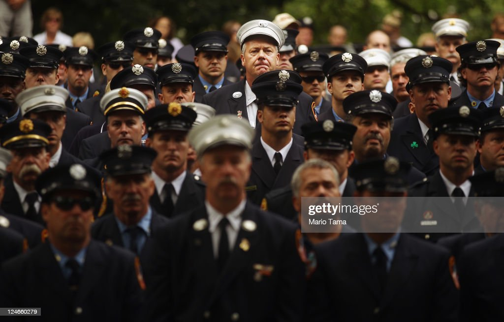 Firefighters attend a memorial service for firefighters killed on 9/11 at the Firemen's Monument at Riverside Park on Septemnber 11, 2011 in New York City. Firefighters from around the world have converged on New York to take part in the anniversary services. New York City and the nation are commemorating the tenth anniversary of the terrorist attacks which resulted in the deaths of nearly 3,000 people after two hijacked planes crashed into the World Trade Center, one into the Pentagon in Arlington, Virginia and one crash landed in Shanksville, Pennsylvania.