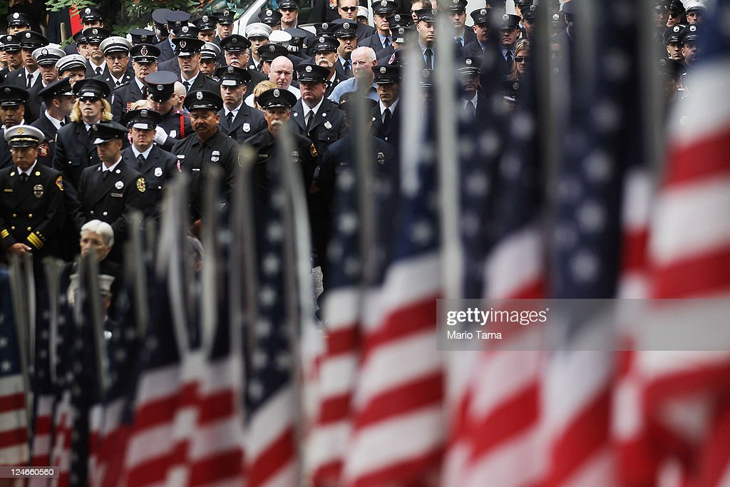 Firefighters attend a memorial service for firefighters killed on 9/11 at the Firemen's Monument at Riverside Park on Septemnber 11, 2011 in New York City. Firegihters from around the world have converged on New York to take part in the anniversary services. New York City and the nation are commemorating the tenth anniversary of the terrorist attacks which resulted in the deaths of nearly 3,000 people after two hijacked planes crashed into the World Trade Center, one into the Pentagon in Arlington, Virginia and one crash landed in Shanksville, Pennsylvania.