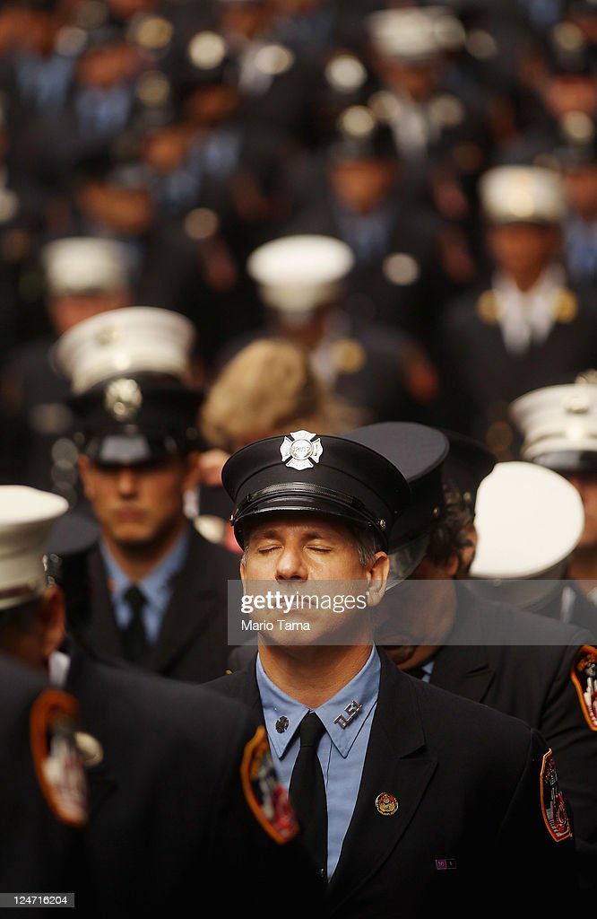 Firefighters attend a memorial service for firefighters killed on the 10th anniversary of the terrorist attacks on lower Manhattan at the Firemen's Monument at Riverside Park on Septemnber 11, 2011 in New York City. Firefighters from around the world have converged on New York to take part in the anniversary services. New York City and the nation are commemorating the tenth anniversary of the terrorist attacks which resulted in the deaths of nearly 3,000 people after two hijacked planes crashed into the World Trade Center, one into the Pentagon in Arlington, Virginia and one crash landed in Shanksville, Pennsylvania.
