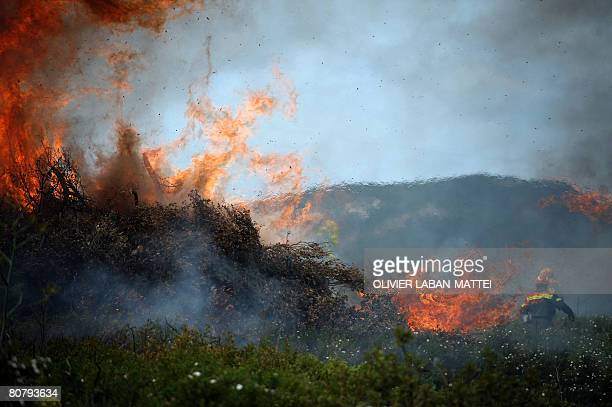 'EU FUNDS MULTINATION FOREST FIREFIGHTING EXERCISE IN SARDINIA' Firefighters attend an exercise on April 18 2008 in North east of the Mediterranean...