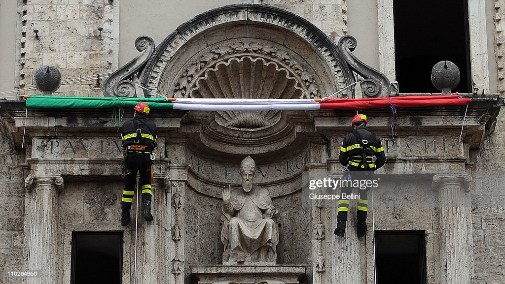 Firefighters attend the celebrations for the 150th anniversary of Italy's unification in the Piazza del Popolo on the Palazzo dei Capitani on March 17, 2011 in Ascoli Piceno, Italy. Events in various Italian cities will celebrate the 150th anniversary of Italy's unification until the end of the year.