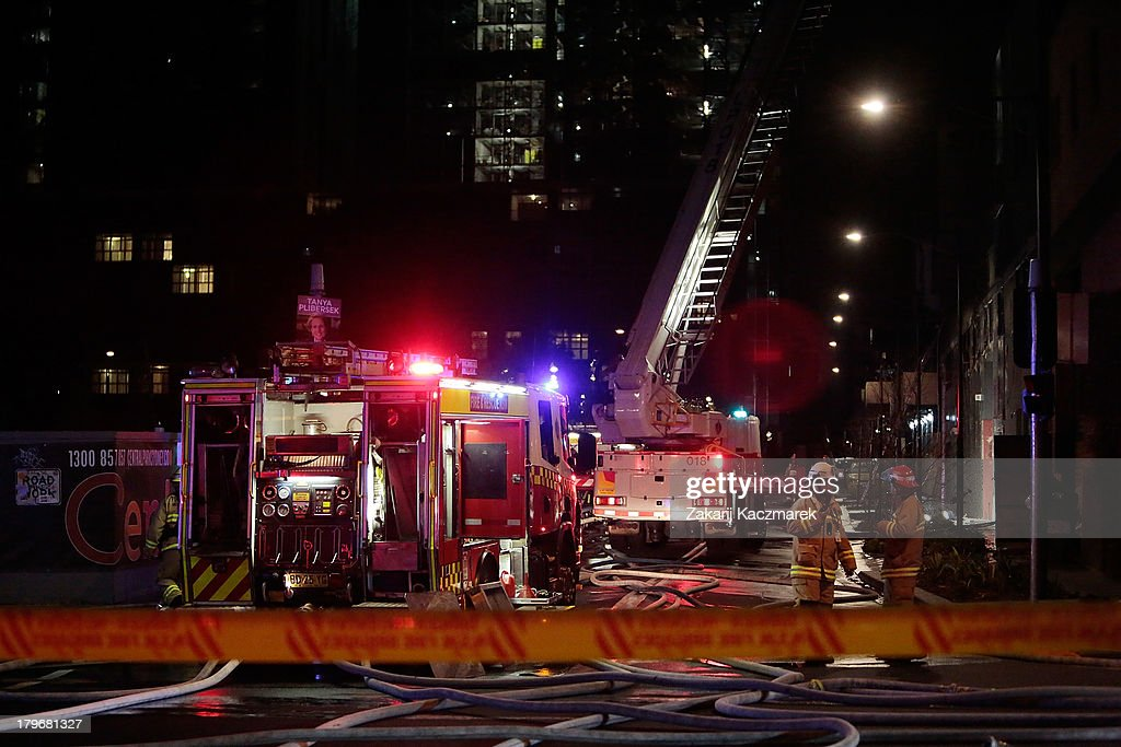 Firefighters attend the scene of a fire in O'Connor Street, Chippendale, a mixed residential and commercial area, on September 6, 2013 in Sydney, Australia.