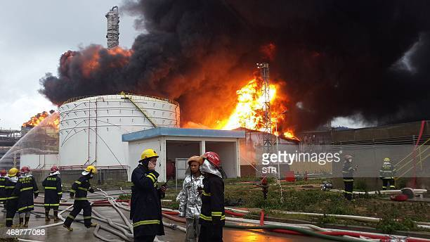 Firefighters battle a blaze after an explosion at a plant producing paraxylene a chemical commonly known as PX in Zhangzhou east China's Fujian...