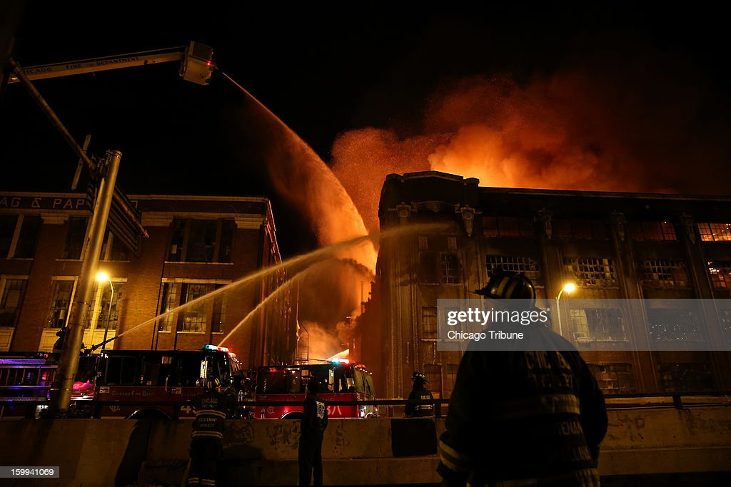 Firefighters battle a blaze at an abandoned warehouse in Chicago, Illinois, on Tuesday, January 22, 2013.