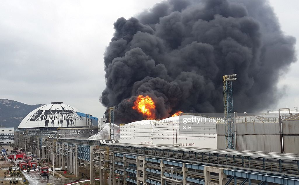 Firefighters battle a blaze following an explosion at a plant producing paraxylene a chemical commonly known as PX in Zhangzhou east China's Fujian...