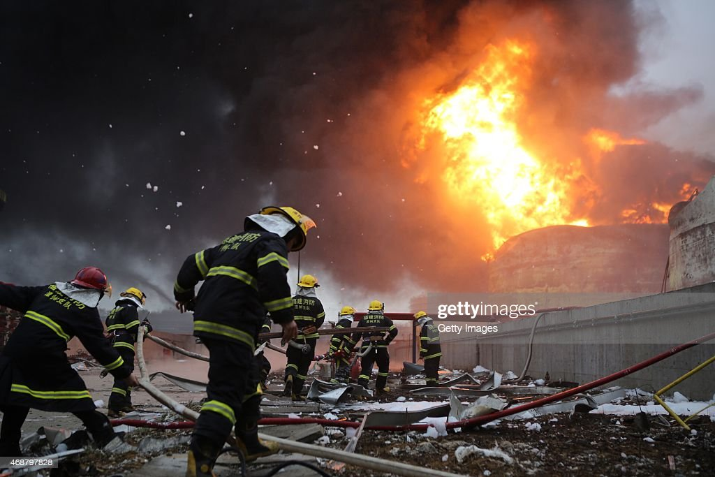 Firefighters battle a fire at the explosion site of PX chemical plant on April 7 2015 in Zhangzhou China Explosion hit Zhangzhou PX chemical plant at...