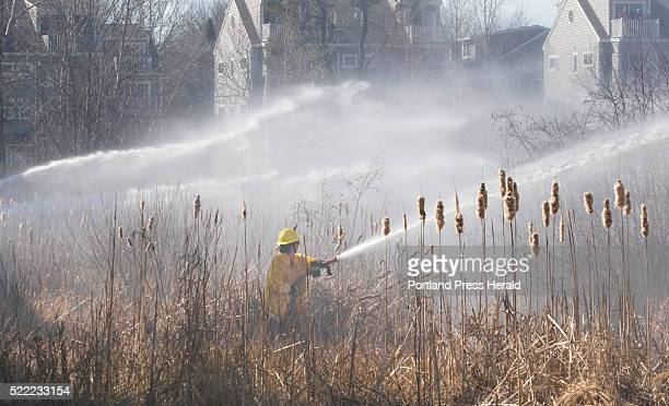 Firefighters battle a fouralarm brush fire in Old Orchard Beach on Friday April 15 2016 that was fanned by strong winds