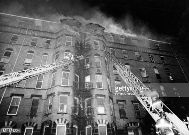 Firefighters battle a fouralarm fire in a sevenstory apartment at 677 Dudley St in the Dorchester neighborhood of Boston Dec 4 1971