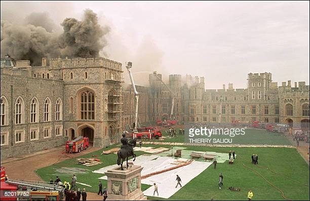 Firefighters battle a huge blaze at Windsor Castle a royal residence 30 miles west of London 20 November 1992 The blaze that reportedly started in...