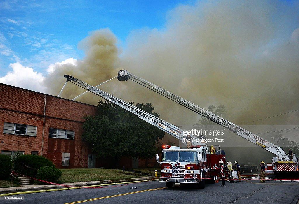 Firefighters battle a huge blaze in a warehouse on S. Pickett street on September, 02, 2013 in Alexandria, VA.