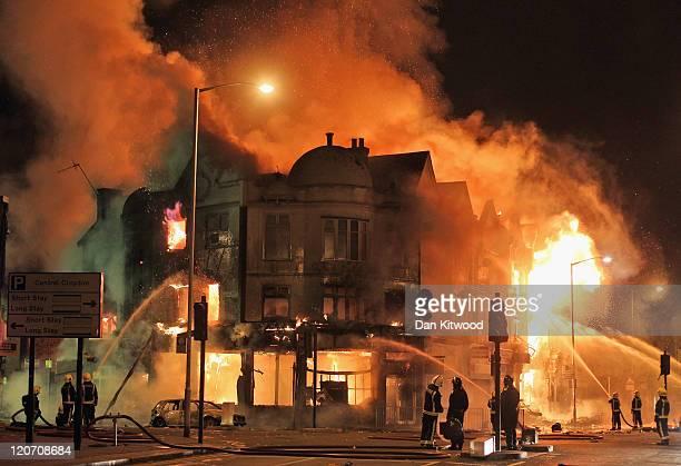 Firefighters battle a large fire that broke out in shops and residential properties in Croydon on August 9 2011 in London England Sporadic looting...