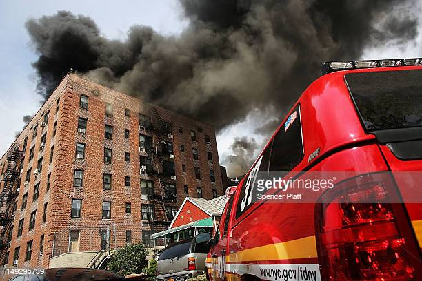 Firefighters battle a sixalarm fire at a sevenstory apartment building in the Prospect Lefferts Gardens of Brooklyn on July 26 2012 in New York City...