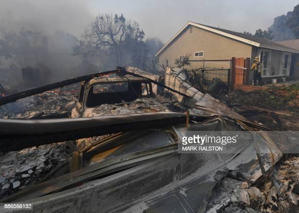 Firefighters battle the Thomas wildfire in Ventura California on December 5 2017 Firefighters battled a windwhipped brush fire in southern California...