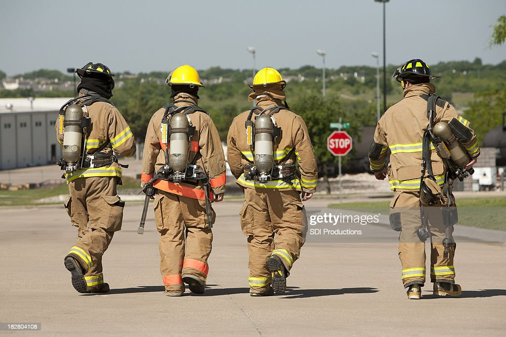 Firefighters Behind Walking Away From Fire